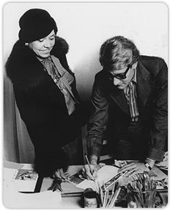 Eunice Johnson consults with Yves Saint Laurent