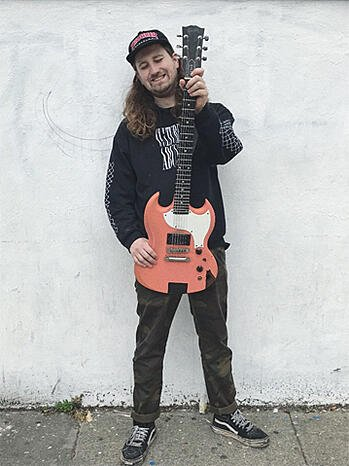 Culture Abuse lead guitarist, John Jr. is pictured with his Gibson SG-X guitar.